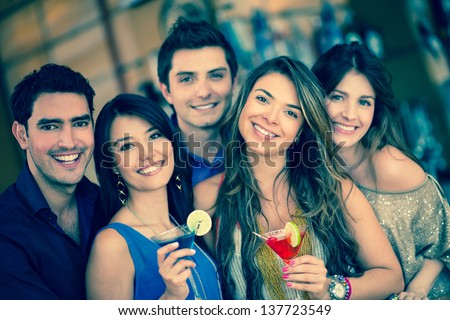 Group of friends going out to a bar and having drinks - stock photo