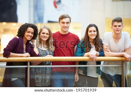 Group Of Friends Hanging Out In Shopping Mall - stock photo