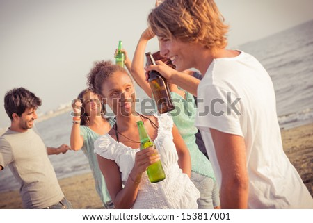 Group of Friends Having a Party at Beach, Italy - stock photo