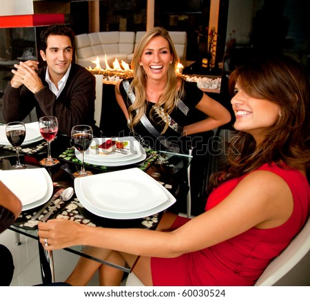 Group of friends having dinner in a nice restaurant