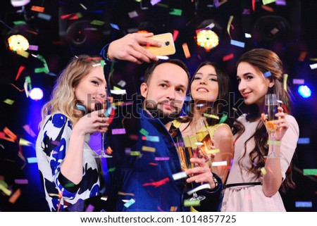 group of friends having fun at the party with a glass of wine or champagne. Holiday, event, celebration, birthday.