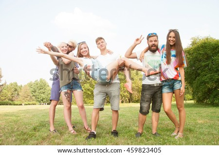 Group of friends having fun in a park on a sunny day