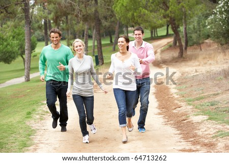 Group Of Friends having fun in park - stock photo