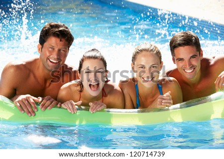 Group Of Friends Having Fun In Swimming Pool - stock photo