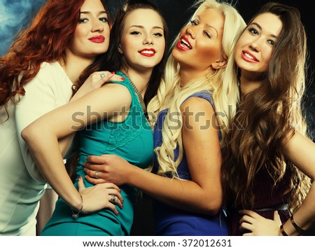 Group of friends having fun on a disco - stock photo
