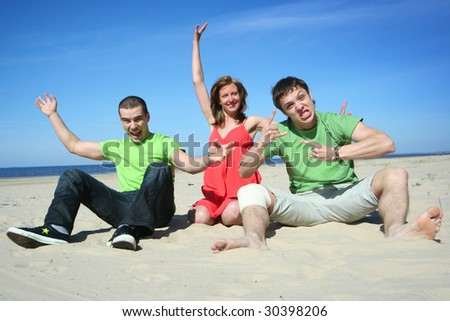 group of friends having fun on the beach - stock photo