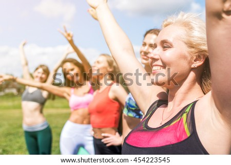 Group Of Friends Having Fun together outdoors. - stock photo