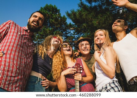 group of friends having fun together outdoors.
