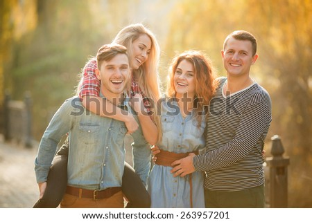 Group Of Friends Having Fun Together Outdoors. Happy group of friends talking and having fun outdoors.  - stock photo