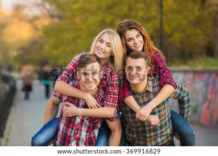 Group Of Friends Having Fun Together Outdoors. Happy group of friends talking and having fun outdoors. friends outdoor. women and men together having fun in city park. - stock photo