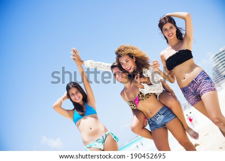 Group of friends having fun, walking at the paradise beach of Cancun - stock photo