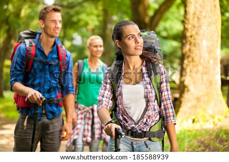 Group of friends hiking and enjoy the beautiful nature during hike  - stock photo