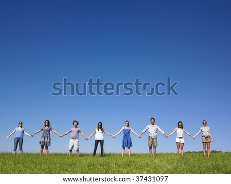 Group of friends holding - stock photo