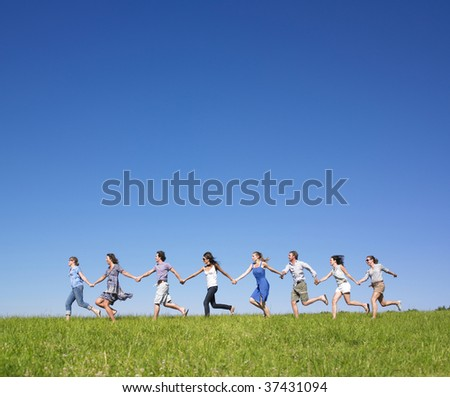 Group of friends holding hands - stock photo