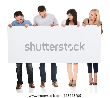 Group Of Friends Holding Placard On White Background - stock photo