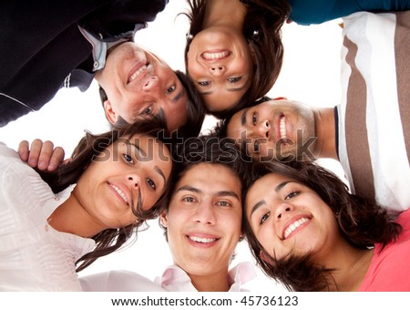 Group of friends in a circle isolated over a white background - stock photo