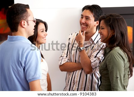 group of friends in an apartment talking - stock photo