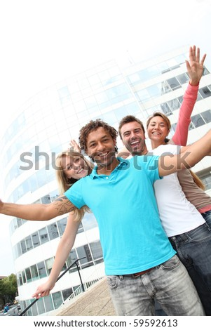 Group of friends in front of building