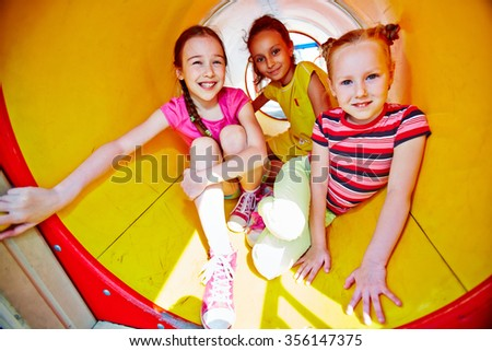 Group of friends in outdoor playground equipment - stock photo