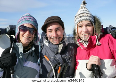 Group of friends in snowsuits - stock photo