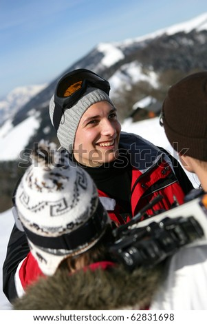 Group of friends in snowy landscape - stock photo