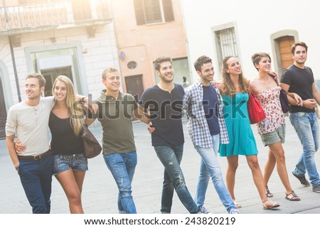 Group of Friends in Town Square, Friendship Theme - stock photo