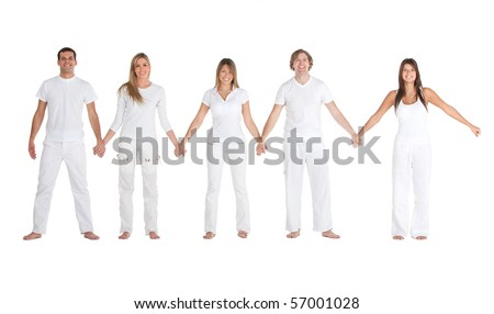 Group of friends in white clothes holding hands - isolated