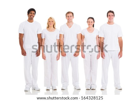 group of friends in white standing in a row - stock photo