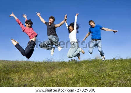 Group of friends jumping in the air - stock photo
