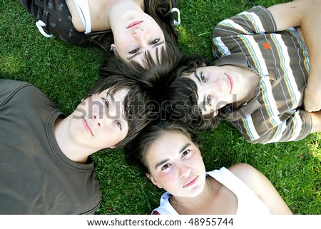 Group of friends laying in a park - stock photo