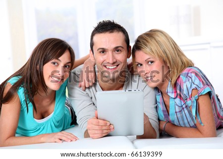 Group of friends laying in sofa at home - stock photo