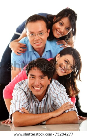 Group of friends lying on the floor � isolated over a white background