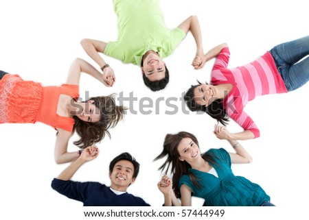Group of friends lying on the floor making a circle - isolated over a white background - stock photo