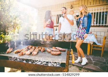 group of friends making barbeque in the backyard concept about good