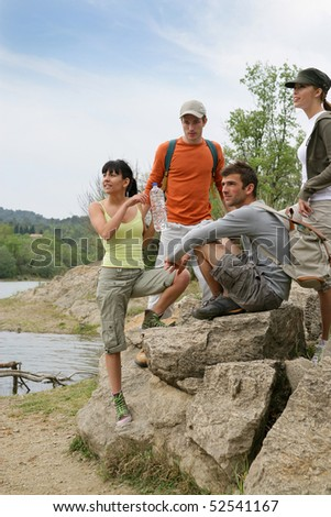 Group of friends making some hike - stock photo