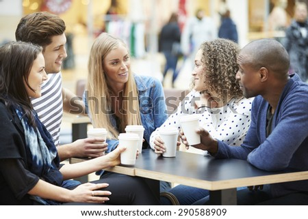 Group Of Friends Meeting In Shopping Mall Caf\x81_ - stock photo