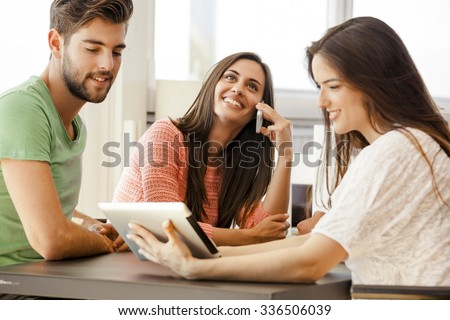Group of friends meeting In the local Coffee Shop - stock photo