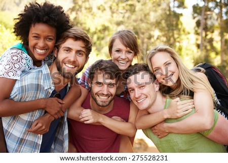 Group Of Friends On Walk Through Countryside Together - stock photo