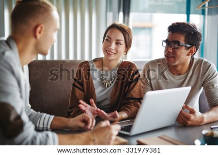 Group of friends or employees consulting about something - stock photo
