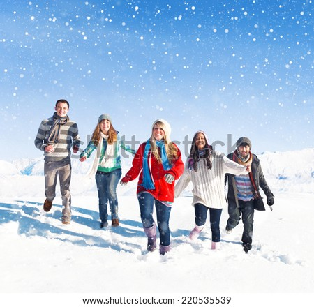 Group of friends outdoors during winter. - stock photo