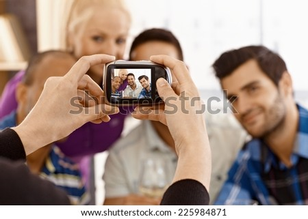 Group of friends photographed by digital camera. - stock photo