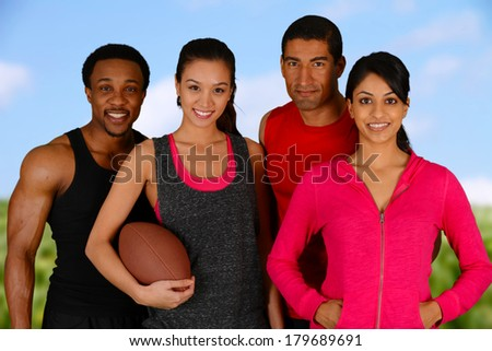 Group of friends playing a game of football together - stock photo
