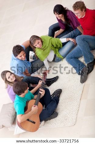 Group of friends playing music and singing - stock photo
