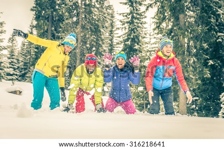 group of friends playing on the snow. concept about winter, fun and people. group of people in a row spraying snow around. - stock photo