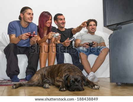 group of friends playing video games - stock photo