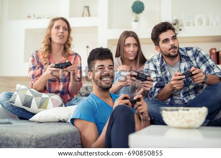 Beautiful Couples Playing Video Games On Stock Photo 695135278