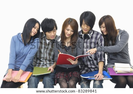 group of friends reading a book - stock photo