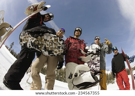 Group of Friends Ready to Snowboard