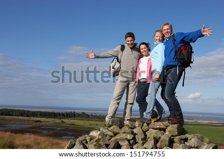 Group Of Friends Resting On Countryside Walk - stock photo
