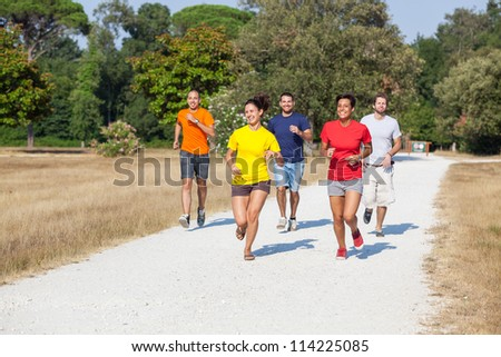 Group of Friends Running Outside - stock photo